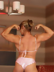 Bodybuilder Emery Miller strips off her 2 piece and flexes her ripped up body.