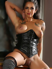 Fit muscular babe Dani Dupree shows off her hot body in a black corset and boots.