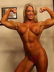 Female bodybuilder Ginger Martin is posing for you in the gym to show you how ripped her abs are, how big and vascular her biceps are, how powerful her pecs and muscular legs are, how gorgeous her glutes are, how sheer her panties are, and how flexible – and spicy - she is.